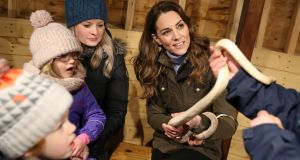 Kate Middleton holds a snake at the Ark Open Farm in Newtownards. Photograph: Chris Jackson/Reuters