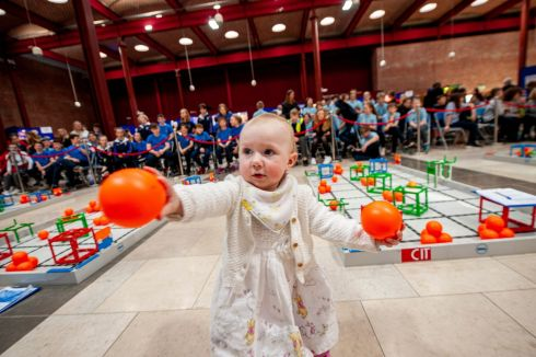 One-year-old Alannah Horgan from Kilworth having lots of fun at at the National Finals of the VEX Robotics Ireland Competition which took place in the Nexus, Student Centre, Cork Institute of Technology. Photograph: Brian Lougheed