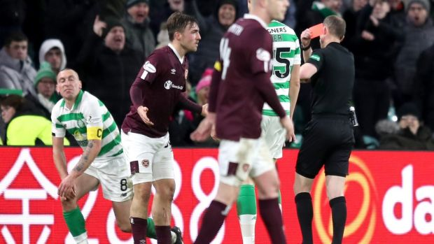 Hearts' Marcel Langer is shown a red card for a tackle on Scott Brown. Photograph: Jane Barlow/PA