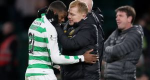 Celtic manager Neil Lennon with Olivier Ntcham during his side's 5-0 win over Hearts. Photograph: Jane Barlow/PA