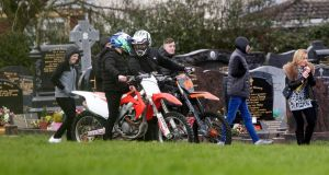 Mourners on motocross bikes at Calvary Cemetery for the funeral of Keane Mulready Woods. Photograph:  Collins Dublin