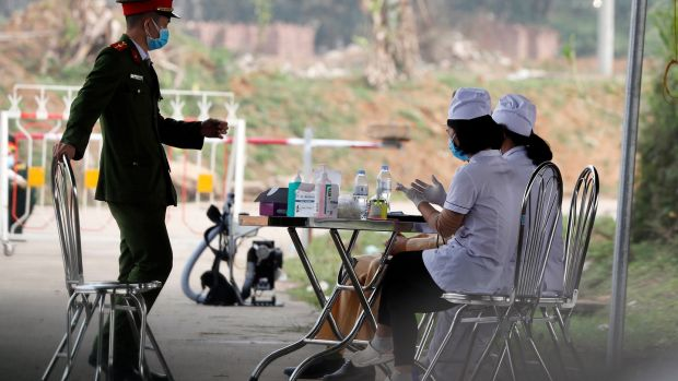 A Vietnamese policeman and two nurses at a checkpoint at Son Loi commune, Vinh Phuc province, Vietnam on february 14th. Photograph: Luong Thai Linh/EPA