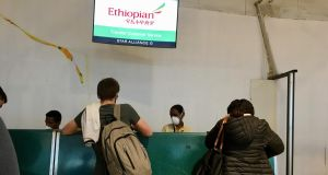 Staff and customers at an Ethiopian Airlines check-in desk at Bole International Airport in Addis Ababa. Photograph: Sally Hayden