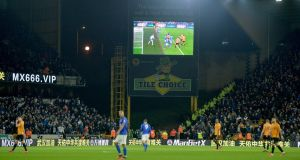 A VAR  decision disallowing Wolves' goal is shown on a giant screen during the  Premier League  match against  Leicester City held at  Molineux stadium. Photograph: Peter Powell/VAR
