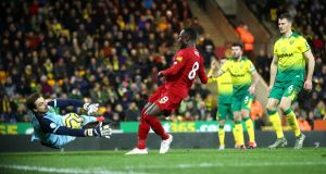 Tim Krul of Norwich City saves from Naby Keita of Liverpool during the second half at Carrow Road. Photo: Julian Finney/Getty Images