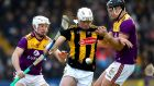 Wexford's Jack O'Connor and Conor Browne of Kilkenny battle for the sliotar. Photo: Ryan Byrne/Inpho