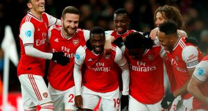 Nicolas Pepe celebrates scoring Arsenal's second goal  with team-mates during the Premier League game against Arsenal at  the Emirates Stadium. Photograph:  Ian Kington/AFP via Getty Images