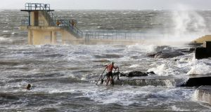 STORMY WATERS: Swimmers take to the water in Salthill, Galway, during Storm Dennis. Photograph: Hany Marzouk
