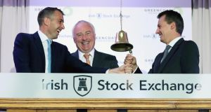 Bertand Gautier, Paul O'Donnell and Ronan Murphy of Greencoat Renewables at the Irish Stock Exchange. Photograph: Robbie Reynolds