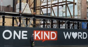 BE KIND: One Kind Word, a slogan based artwork on Middle Abbey Street, Dublin, which was commissioned by 3Ts, a charity working to help prevent deaths by suicide through research, intervention and support. Photograph: Dara Mac Dónaill/The Irish Times