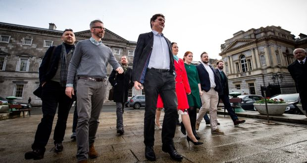 Green Party leader Eamonn Ryan is pictured at Leinster House with the party's 11 other TDs and its Senator on Tuesday. Photograph: Tom Honan/The Irish Times.