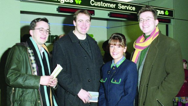 Marcus Dowling, Dara Ó Briain, and Bernard Dunleavy, with Elaine Kelly of Aer Lingus after their victory in The Irish Times debate in 1994. Photograph: Jack McManus/The Irish Times