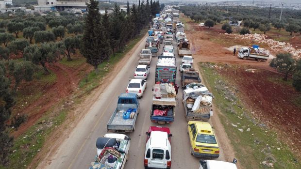 Displaced Syrians drive through the town of Hazano in Idlib's northern countryside on February 11th as people flee a pro-regime offensive. Photograph: Aref Tammawi/AFP via Getty Images