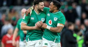 Ireland's Robbie Henshaw and Bundee Aki celebrate after their win against Wales in the Guinness Six Nations Championship Round 2 match at the Aviva Stadium, Dublin on February 8th. Photograph: Gary Carr/Inpho