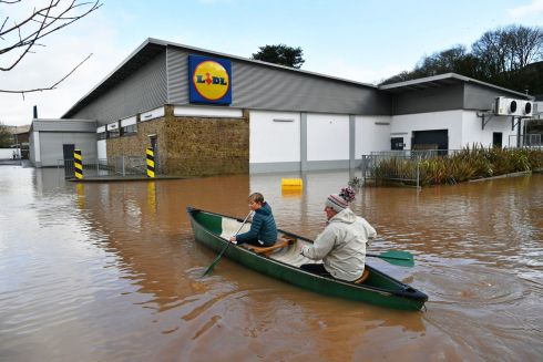 Nearby residents making their way towards Lidl in a canoe in Monmouth, in the aftermath of Storm Dennis. Photograph: Ben Birchall/PA