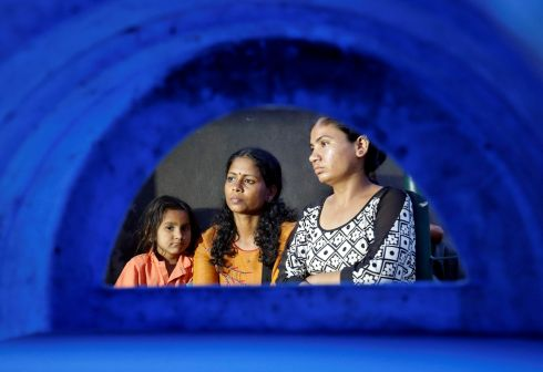 Aswathy Jwala (centre), a social activist, sits on a hunger strike to oppose the building of a wall along a slum area, that authorities said was built as part of a beautification drive along a route, that US president Donald Trump and India's prime minister Narendra Modi will be taking during Mr Trump's upcoming visit, in Ahmedabad, India. Photograph: Amit Dave/Reuters