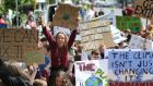 Students take part in a climate protest in Dublin last summer.  Photograph: Nick Bradshaw for The Irish Times