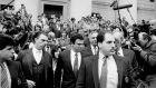 The financier Michael Milken (centre) leasves federal court in New York on April 7, 1989. Photograph: The New York Times