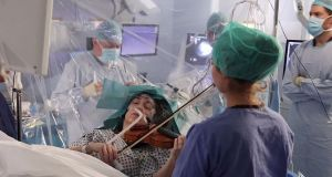 Dagmar Turner plays during brain surgery. Photograph: King's College Hospital/via Getty