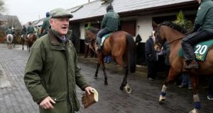 Trainer Willie Mullins during a visit to his yard in Closutton on Wednesday: he is readying   a battalion of up to 60 horses for Cheltenham. Photograph:   Brian Lawless/PA Wire