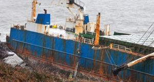 Marine salvage experts will assess how best to remove a number of sealed barriers containing fuel and oil from the ghost ship, MV Alta which remains stranded on rocks near Ballycotton in East Cork.  Photograph: David Creedon /Anzenberger