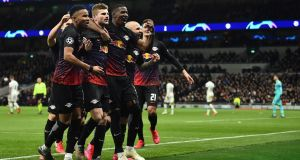 RB Leipzig's German striker Timo Werner (second from left) celebrates scoring from the penalty spot during the Champions League round of 16 first leg against Tottenham Hotspur at the Tottenham Hotspur Stadium. Photograph: Glyn Kirk/Ikimages/AFP via Getty Images
