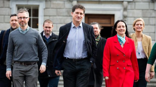 Green Party leader Eamon Ryan with some of the party's new TDs outside Leinster House. Photograph: Tom Honan