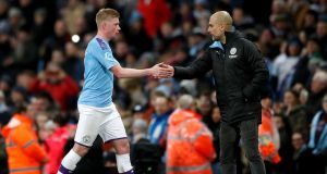 Manchester City manager Pep Guardiola  shakes hands with  Kevin De Bruyne  as he leaves the field during the Premier League match against West Ham at the Etihad Stadium. Photograph: Martin Rickett/PA Wire
