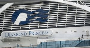Passengers  seen on  deck of the quarantined Diamond Princess cruise ship, docked at the Daikoku Pier. Photograph: Tomohiro Ohsumi/Getty