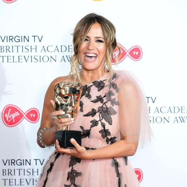 Caroline Flack with the Bafta awarded to Love Island in 2018. The reality show is clearly determined to push on from her tragic passing. Photograph: Ian West/PA Wire