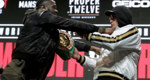 Deontay Wilder and Tyson Fury get into an altercation during their press conference at the MGM Grand Las Vegas. Photograph: Getty Images