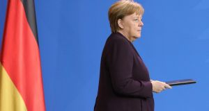 German chancellor Angela Merkel speaks on the shooting in Hanau at the chancellery in Berlin. Photograph: Omer Messinger/EPA