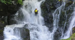 Nathan Kingerlee of Outdoors Ireland, canyoning at Torc Waterfall in Killarney. Photograph: Valerie O'Sullivan
