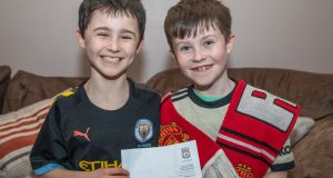Manchester United fan  Daragh Curley (10) and his brother Dylan with his letter from Jürgen Klopp. Photograph: North West Newspix