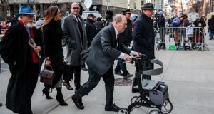 Harvey Weinstein, using a walker, arrives at the Manhattan Criminal Court in New York for his rape and sexual assault trial on Thursday. Photograph: Sarah Blesener/The New York Times