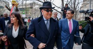 Roger Stone (centre), a longtime political advisor to US president Donald  Trump, and his wife Nydia (left) arrive for his sentencing hearing at the DC Federal District Court in Washington, DC on Thursday. Photograph: Shawn Thew/EPA