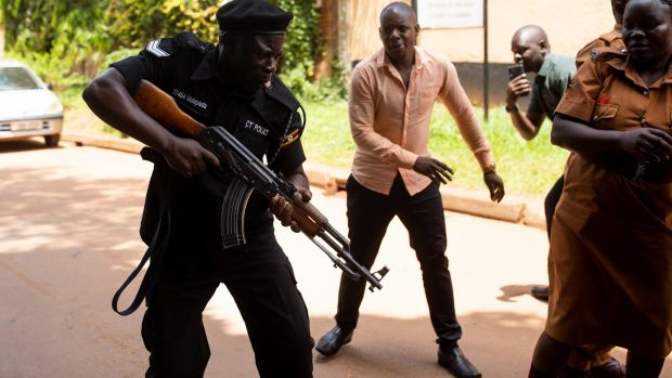Police fire live rounds outside the courtroom in Kampala where Stella Nyanzi had her conviction overturned. Photograph: Luke Dray/Getty Images