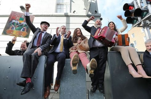'UP THE KINGDOM': Independent TDs Michael Healy-Rae and Danny Healy-Rae mark their arrival at the Dáil with a family sing-along on Kildare Street with councillors Johnny (second left) and Maura (right) and Danny's daughter Elaine. Photograph: Nick Bradshaw