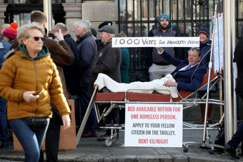 PROTEST VOTE: Seán O'Leary lies on a stretcher outside Leinster House as the 33rd Dáil prepares to sit at Leinster House in Dublin. Mr O'Leary ran as an Independent candidate in 11 constituencies in the general election, received 985 votes. Photograph: Paul Faith/AFP via Getty Images