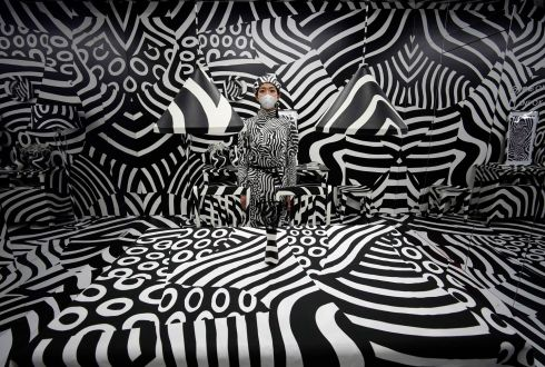 HYPNOTIC: A young woman poses for photographs in Japanese artist Shigeki Matsuyama's art installation 'Seen behind watching' during the 'rooms 40' fashion and design trade show at Yoyogi National Stadium in Tokyo, Japan. Photograph: Franck Robichon/EPA