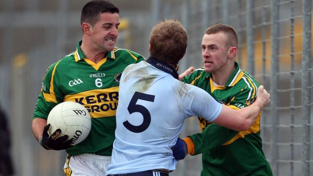 Paul Griffin of Dublin clashes with Aidan O'Mahony and Barry John Keane of Kerry in their Allianz Football National League Round 1 match in February 2010. Photograph: Donall Farmer/Inpho