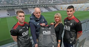 Tracey Kennedy, chairperson Cork County Board, with Kevin Fahive, Cork football manager Ronan McCarthy and Tom Clancy at the launch of the  jersey to commemorate former lord mayors Tomás MacCurtain and Terence McSwiney. Photograph: Jim Coughlan