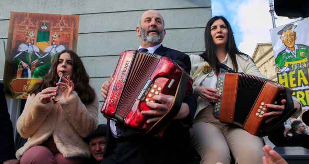 Members of the Healy-Rae family perform outside Leinster House on Kildare Street, Dublin. Photograph: Gareth Chaney/Collins