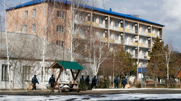 Ukrainian National Guards soldiers patrol an area at the sanitarium where the evacuees from the Chinese city of Wuhan are to be quarantined, in Novi Sanzhary village on Friday. Photograph: Efrem Lukatsky/PA