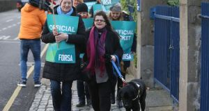 Staff in health and social care organisations striking on Friday. Forsa held a media event at the National Council for the Blind on Whitworth Road. Audrey Tormey (centre), shop stewart, NCBI and her guide dog Zorro take part. Photograph: Nick Bradshaw/The Irish Times