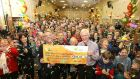 The residents of the townland of Drumgoon in Co Cavan celebrate after they were presented with a cheque for €256,142 by National Lottery officials. Photograph: Mac Innes Photography
