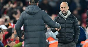 Manchester City's Pep Guardiola shakes hands with Liverpool's Jürgen Klopp at Anfield last November. Photograph: Getty Images