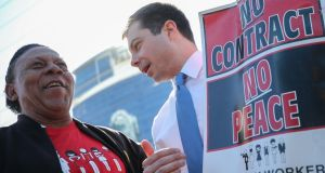 Democratic presidential candidate Pete Buttigieg speaks with a member of the Culinary Workers' Union on a picket line outside the Palms Casino Resort in Las Vegas. Photograph: Mario Tama/Getty Images
