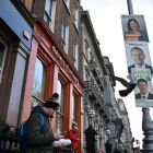 A pedestrian walks past election posters in Dublin ahead of the general election. File photograph: Ben Stansall/AFP via Getty Images