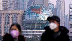 People wearing  masks  in the financial district of Pudong in Shanghai, China. Photograph:  Reuters/Aly Song